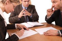 Business meeting - 3 people - signing contract. Business meeting - 2 men, 1 woman, - signing contract Royalty Free Stock Photography
