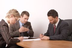 Business meeting - 3 people - signing contract - general Stock Images