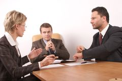 Business meeting of 3 persons. In the office Royalty Free Stock Photo