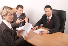 Business meeting of 3 persons. Business people preparing contract Royalty Free Stock Photography