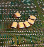 Business meeting. A group of micro-circuits on a printed board Stock Photos