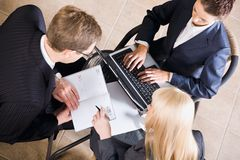 Business meeting. Businesspeople gathered around a table for a meeting and brainstorming Royalty Free Stock Photo