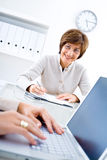 Business meeting. Senior businesswoman a working at desk in office, smiling Royalty Free Stock Image