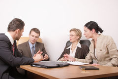 Business meeting of 4 persons. Group of people negotiate at the desk Royalty Free Stock Image
