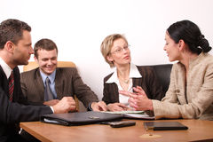 Business meeting of 4 persons. Group of people negotiate at the desk Royalty Free Stock Images