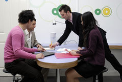 Business meeting. A group of young business entrepreneurs in a casual contemporary office space Stock Photos