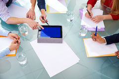 Business meeting aerial hands paper and pad Stock Images