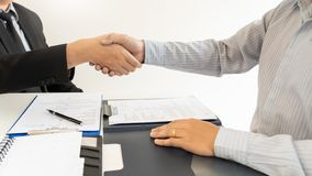 Business Meeting agreement Handshake concept, Hand holding after finishing up dealing project or bargain success at negotiation ov royalty free stock images
