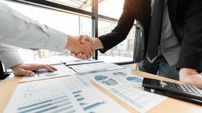 Business Meeting agreement Handshake concept, Hand holding after finishing up dealing project or bargain success at negotiation ov stock image