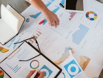 Business marketing strategy infographic diagrams. Business meeting. Ambitious marketing strategy. Infographic diagrams analysis. Team members discussing revenue royalty free stock photos