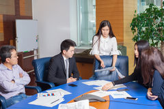 Business meeting Asian nationality people. Business meeting, Asian people sitting for a glass table with business plan on high floor in the office. Asian Stock Images