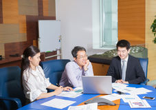 Business meeting Asian nationality people. Business meeting, Asian people sitting for a  table with business plan on high floor in the office. Asian nationality Royalty Free Stock Photography
