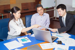 Business meeting Asian nationality people. Business meeting, Asian people sitting for a  table with business plan on high floor in the office. Asian nationality Royalty Free Stock Images