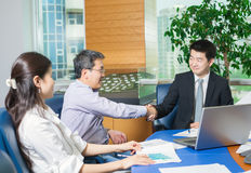 Business meeting Asian nationality people. Business meeting, Asian people sitting for table with business plan on high floor in the office. Asian nationality Royalty Free Stock Photo
