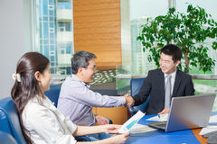 Business meeting Asian nationality people. Business meeting, Asian people sitting for table with business plan on high floor in the office. Asian nationality Stock Image