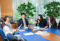 Business meeting Asian nationality people. Business meeting, Asian people sitting for table with business plan on high floor in the office. Asian nationality Royalty Free Stock Images