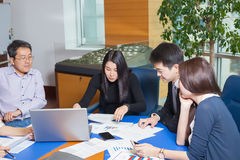 Business meeting Asian nationality people. Business meeting, Asian people sitting for a table with business plan on high floor in the office. Asian nationality a Stock Image