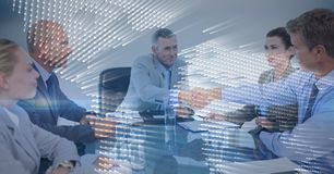 Business meeting with behind blue map graphic overlay against grey background Stock Photos