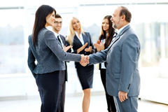 Business meeting business partners in an office with a handshake Stock Images