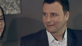 Business meeting of business partners with their wives. In a restaurant stock video footage