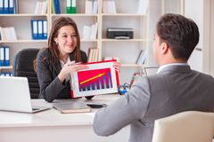 The business meeting between businessman and businesswoman. Business meeting between businessman and businesswoman royalty free stock photography