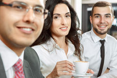 Business meeting in cafe. Close up of three business colleagues on a coffee break Stock Photos