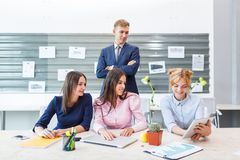 Discussing the deal with young business partners in the office. stock photos