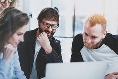 Business meeting concept.Coworkers team working with mobile computer at modern office.Analyze business plans,using. Laptop.Blurred background.Flares Royalty Free Stock Photos