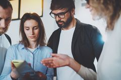 Business meeting concept.Coworkers working with mobile devices at modern office.Blurred background.Horizontal. stock image