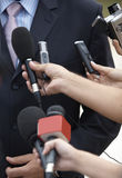 Business meeting conference journalism microphones. Close up of conference meeting microphones and businessman Stock Photos