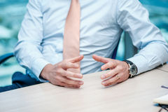 Business meeting. Confident businessman sitting at the table Stock Photo