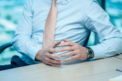 Business meeting. Confident businessman sitting at the table Royalty Free Stock Images