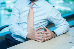 Business meeting. Confident businessman sitting at the table at Royalty Free Stock Images