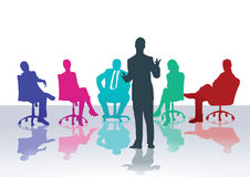 Business meeting or counseling course. Silhouette of business men and women seated listening to standing talker in business meeting or counseling course Royalty Free Stock Photography