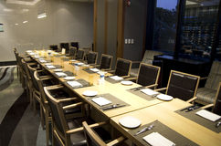 Business meeting dining table in hotel restaurant. A big private room for business dining in a hotel restaurant Stock Photography