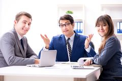 The business meeting with employees in the office Stock Images