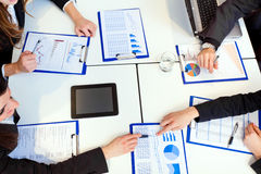 Business meeting: group of businesspeople at work Stock Photos