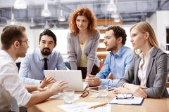 Business meeting. Group of business partners listening to colleague at meeting Stock Photography