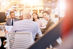 Business meeting indoors in colourful modern office space stock photography