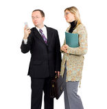 Business meeting interrupted by a phone call. Business meeting  - a man is interrupted by a phone call Royalty Free Stock Images