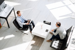 Business meeting in lobby Stock Photo