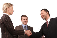 Business meeting - man and woman handshake stock photo