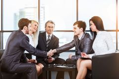 Business meeting with management and handshakes. A group of businessmen discussing the policy of the company in the office stock photos