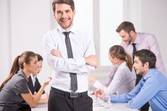 Business meeting - manager discussing work with his colleagues. Stock Images