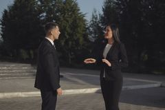 Business meeting men and pretty woman greeting each other with handshake outdoors stock image