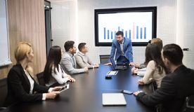 Business meeting in modern conference room. Business meeting and presentation in modern conference room for colleagues stock photo