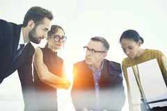 Business meeting networks collaborating on meeting to finish project in time stock images