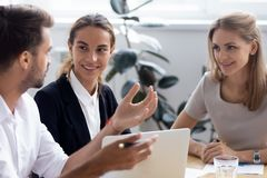 Diverse millennial entrepreneurs share experiences and discuss n. During business meeting in office conference room diverse millennial entrepreneurs stock photography