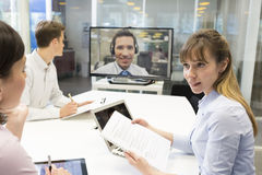 Business meeting in office, group Of Businesspeople In video con Royalty Free Stock Image