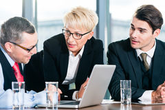 Business - meeting in office, people working with document. Business - meeting in office, the businesspeople with boss and team are discussing a document on stock photos